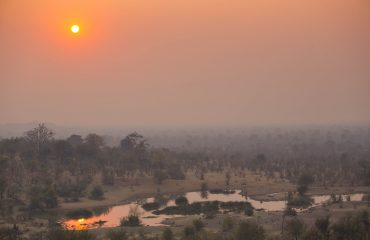 Victoria Falls Safari Lodge Waterhole view at sunset
