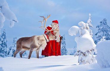 visit-rovaniemi-santa-claus-reindeer-snow-frontpage